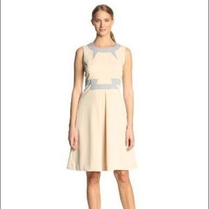 Magaschoni cream and grey A-line dress.